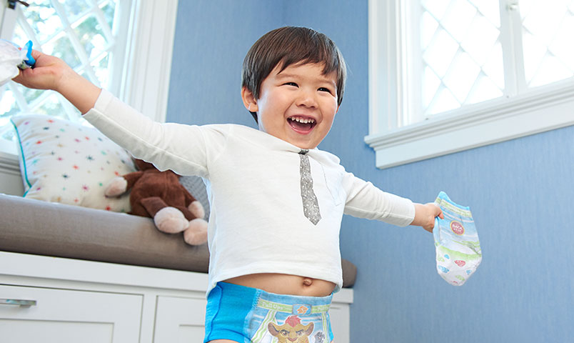Boy celebrating in training pants