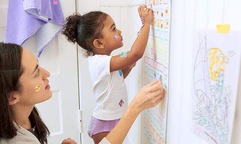 Girl with sticker chart