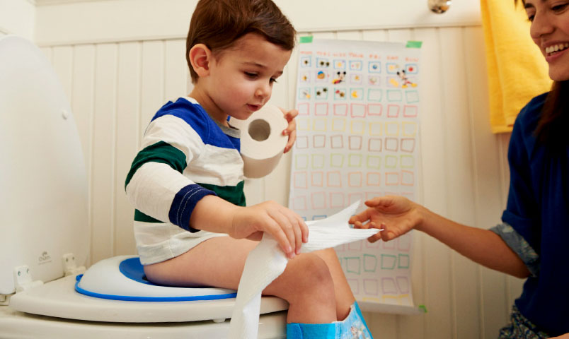 Little boy figuring out potty training