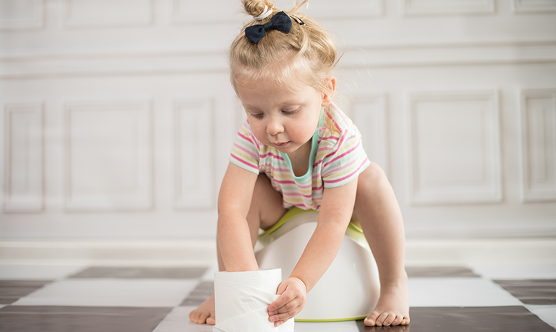 Little girl playing with toilet paper
