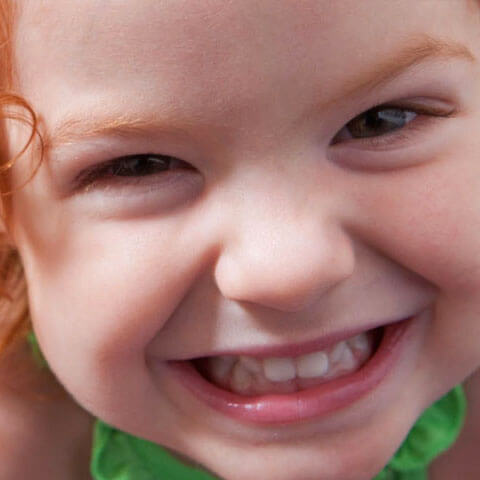 Up close photo of child smiling