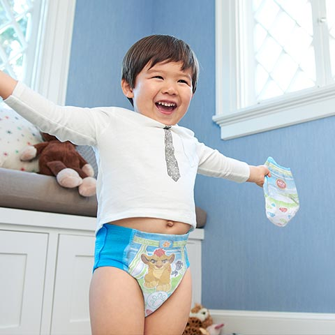 Boy in training pants celebrating
