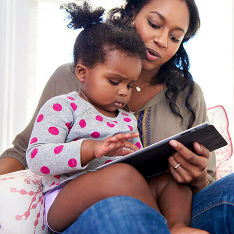 Parents read to child to calm her down before bedtime