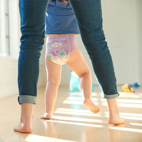 Pull-Ups® Potty Training Program - Girl and Mother walking to potty