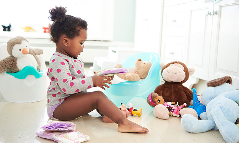 Child talks to stuffed animal friends about potty training as she gets used to the potty and Pull-Ups
