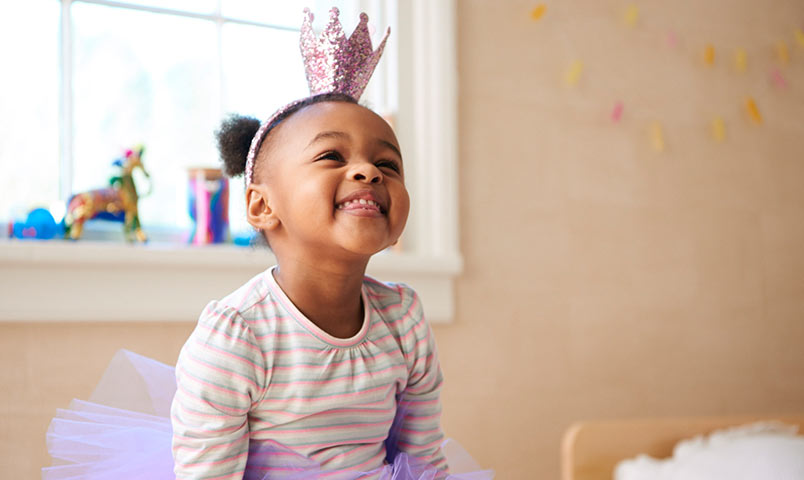 Little girl smiling with a potty crown