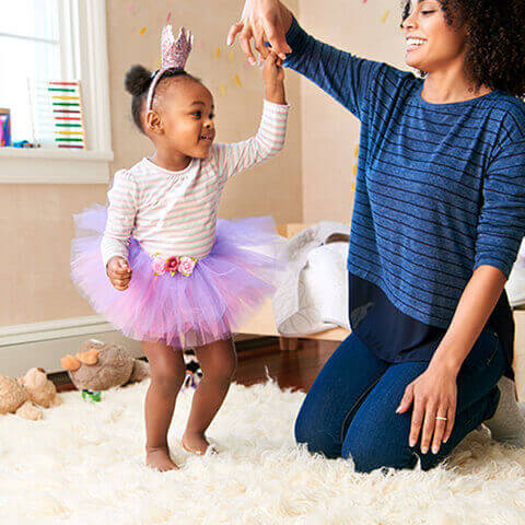 Mom dancing with child as a a positive reward for potty successes