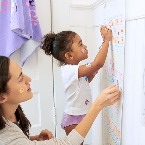 Mother and Daughter Updating Potty Chart