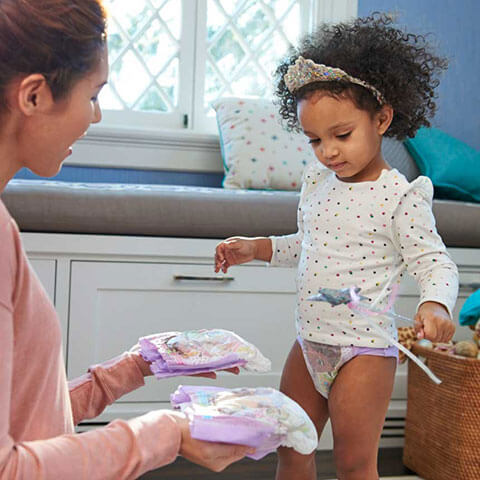 Mom and daughter choosing diaper options